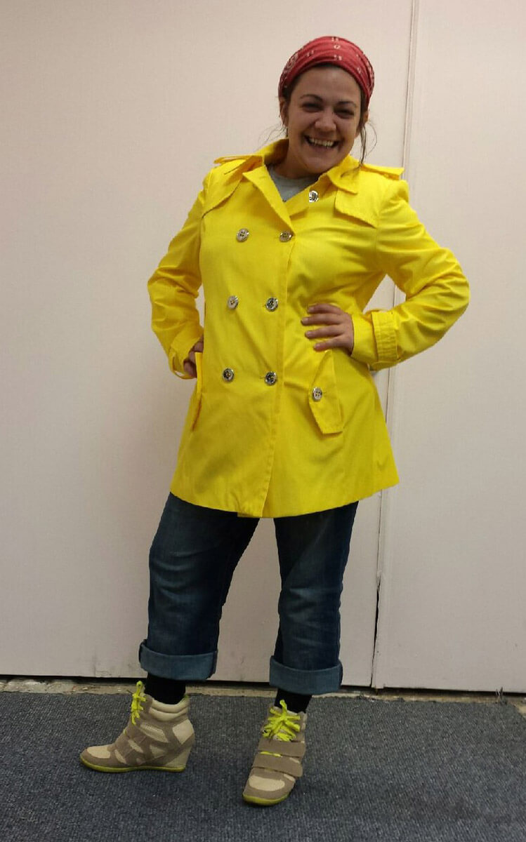 Nicole Bruce strutting her new rain gear from My Sister's Closet